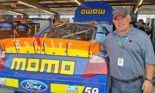 Carlos Lira pose with 59 car