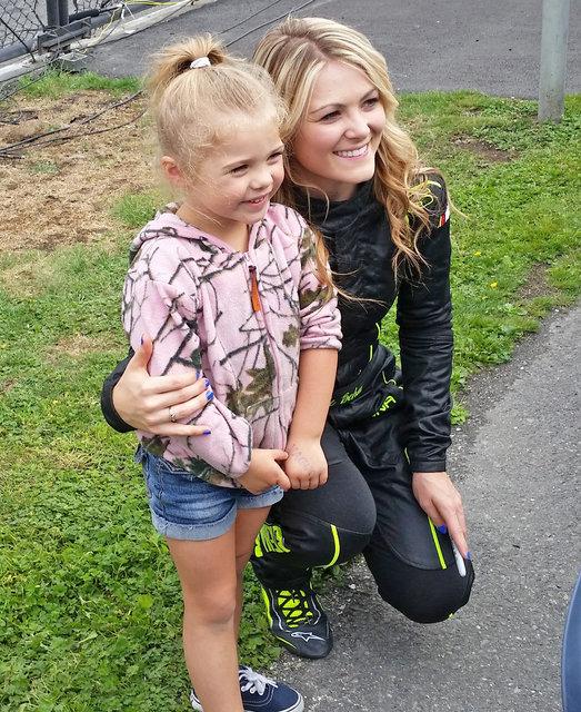 Nicole Behar pose with child