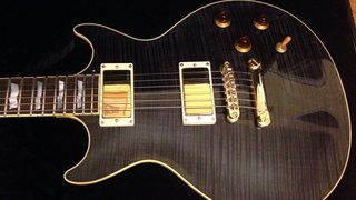 Beautiful flame top nice light brown figured rosewood a really nice khdc ESP in stblk