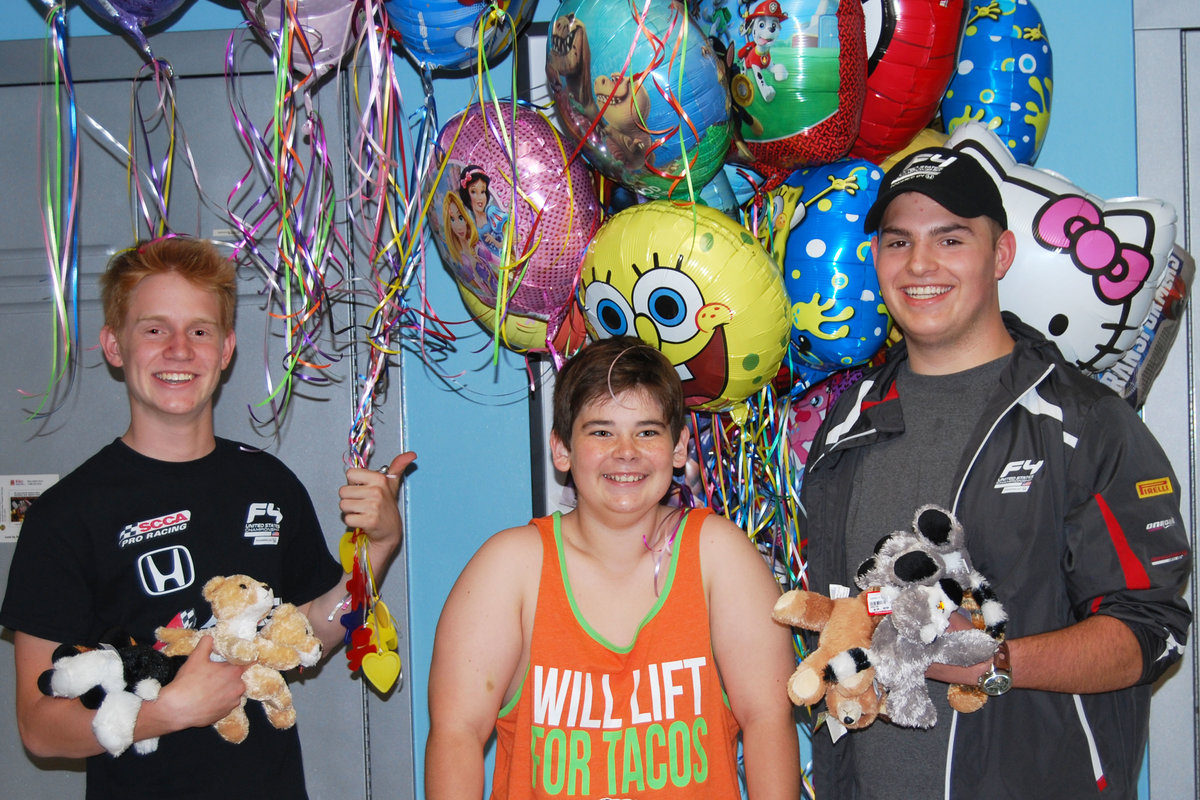 F4 Drivers in Action: Entwistle and Abel Spread Joy at Children's Hospital