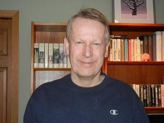 Jon R Brakke